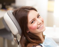 Woman smiling in the dental chair before sedation at West End Dental