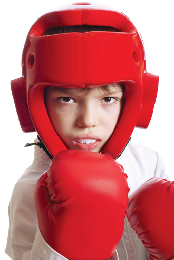 Child with sparring gloves helmet and mouthguard in Portland, OR